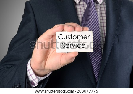 picture of man hand with card with customer service text - stock photo