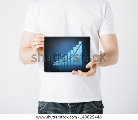 picture of man hands holding tablet pc with graph - stock photo