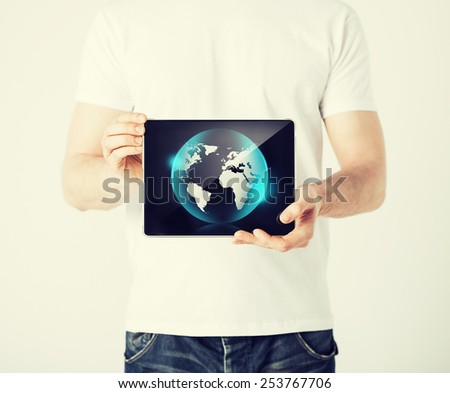 picture of man hands holding tablet pc with sign of globe - stock photo