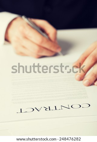 picture of man hands signing contract - stock photo
