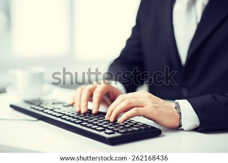 picture of man hands typing on keyboard - stock photo