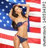 picture of model in bikini with american flag - stock photo
