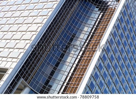 picture of modern multistory building made of glass and concrete - stock photo