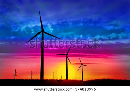 Picture of modern production of electricity - a powerful wind turbines in the background of beautiful nature - stock photo