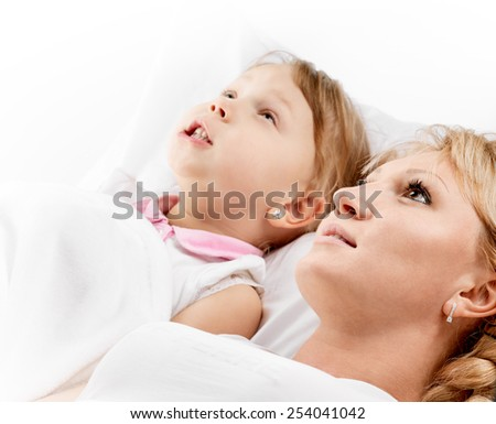 picture of mother and daughter whispering gossip - stock photo