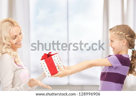 picture of mother and little girl with gifts - stock photo