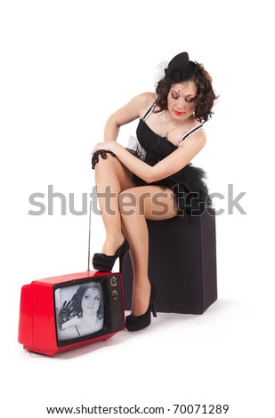 Picture of old-fashioned girl watching old tv - stock photo
