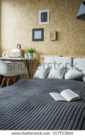 Picture of open book on the bed