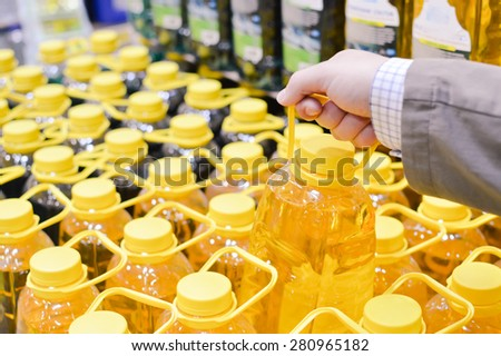 Picture of person choosing or packing bottles in row on copy space background - stock photo