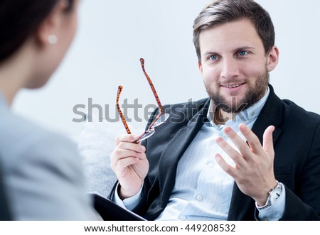 Picture of positive male therapist helping female patient - stock photo
