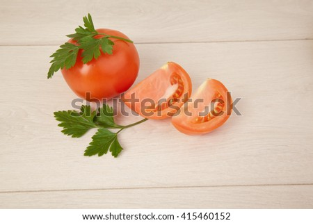 Picture of red tomatoes and parsley - stock photo