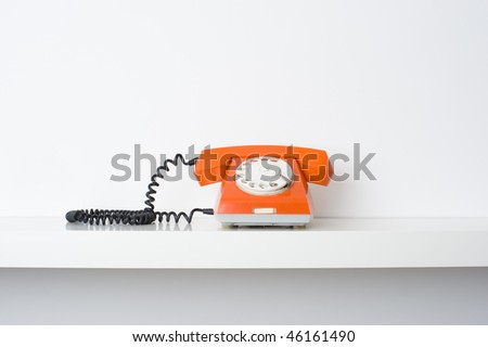 Picture of retro telephone on shelf. Many lot of copyspace - stock photo