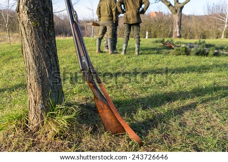 Picture of rifle in front hunters. - stock photo