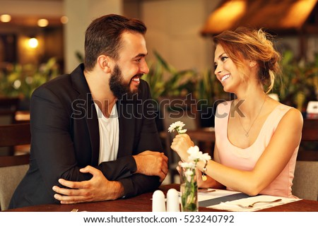 Picture of romantic couple dating in restaurant