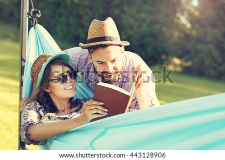 Picture of romantic couple relaxing in hammock