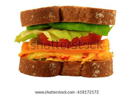 Picture of sandwich made from whole wheat bread, vegetable omelet, slices of cheddar cheese and tomato,  lettuce leaves, over white background