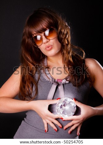 Picture of sexy girl holding a diamond