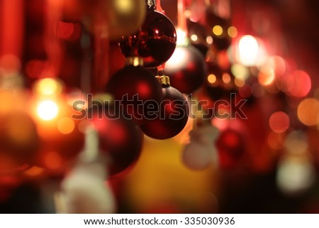 Picture of shiny and blurred red Christmas garland made from baubles of different sizes texture and shades, horizontal picture - stock photo