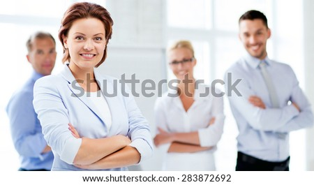 picture of smiling attractive businesswoman in office