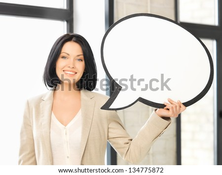 picture of smiling businesswoman with blank text bubble - stock photo