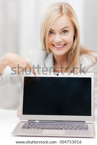 picture of smiling businesswoman with laptop computer - stock photo