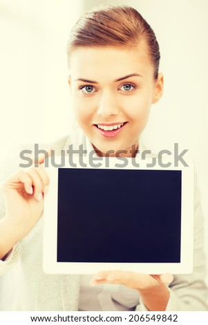 picture of smiling businesswoman with tablet pc in office - stock photo