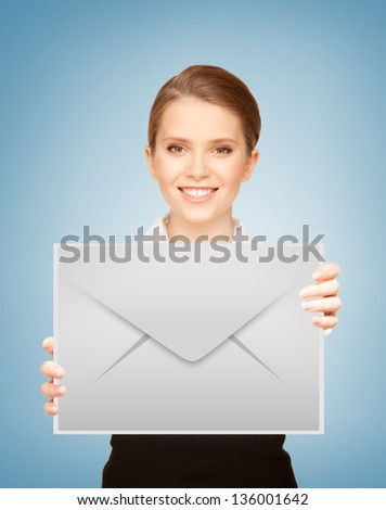 picture of smiling girl showing virtual envelope - stock photo