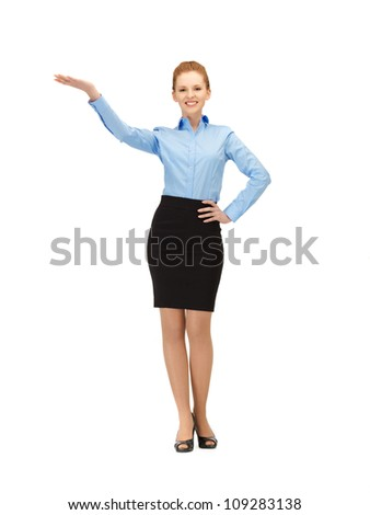 picture of smiling stewardess showing direction