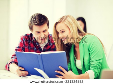 picture of smiling student girl and guy reading book at school