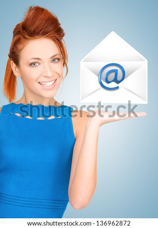 picture of smiling woman showing virtual envelope - stock photo