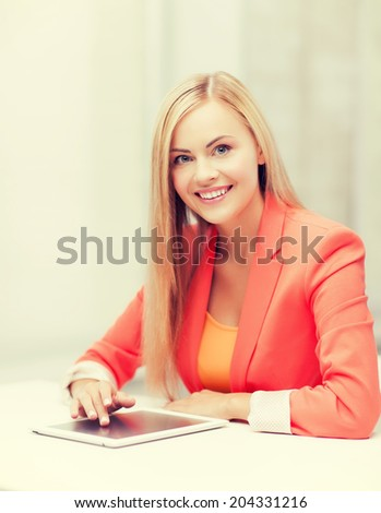 picture of smiling woman with tablet pc