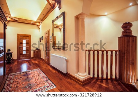 Picture of spacious hallway with wooden floor and decorative rug - stock photo