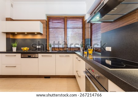 Picture of spacious kitchen with black wheat