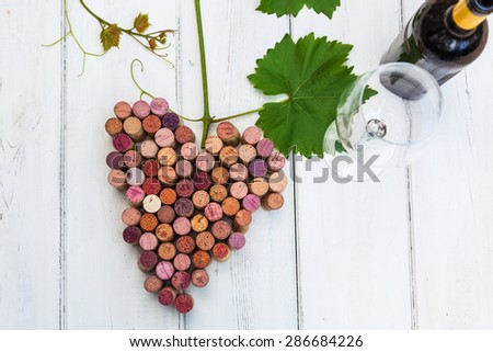 picture of stylized bunch of grapes with wine cork and glass and bottle of wine - stock photo
