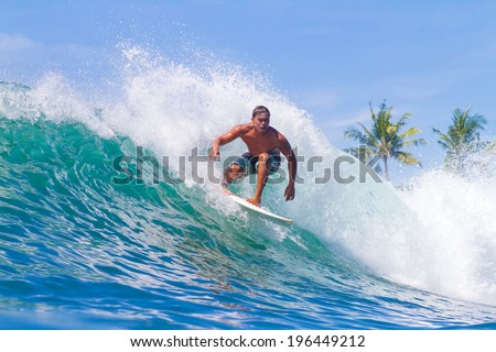 Picture of Surfing a Wave. Bali Island. Indonesia. - stock photo