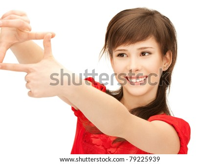 picture of teenage girl creating a frame with fingers - stock photo