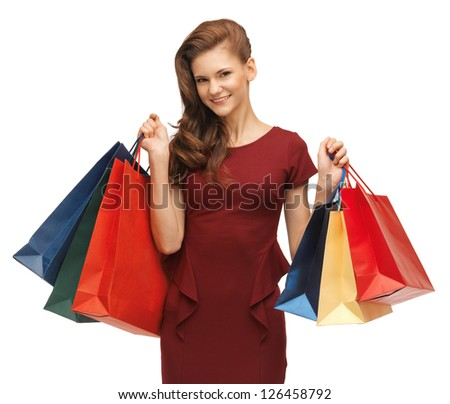 picture of teenage girl in red dress with shopping bags