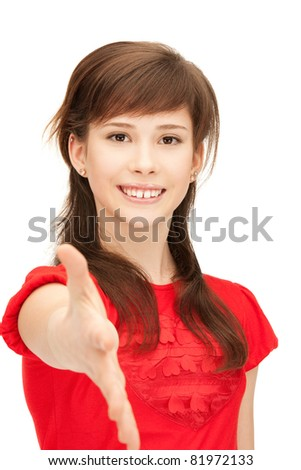 picture of teenage girl with an open hand ready for handshake - stock photo