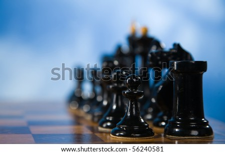 Picture of the chessmen on a chessboard - stock photo