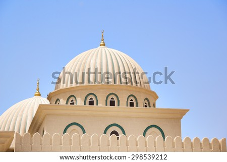 Picture of the dome of a mosque with blue sky in Oman - stock photo