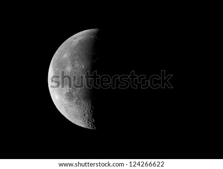 picture of the third (last) quarter moon, taken by telescope - stock photo