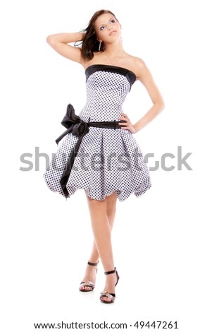 Picture of the young beautiful girl in elegant dress on white background