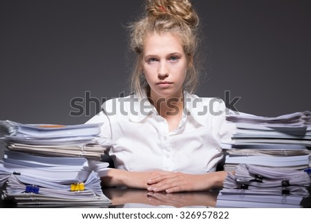 Picture of tired ambitious female trainee abused by employer - stock photo