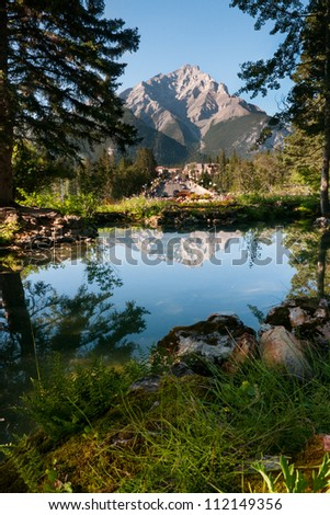 Picture of town of Banff overshadowed by a Rocky Mountain in the background - Banff National Park, Alberta, Canada - stock photo