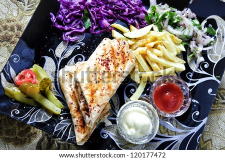 Picture of traditional Eastern warm sandwich arranged with garnish. - stock photo