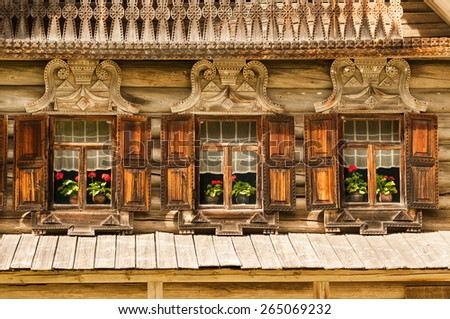 Picture of traditional Russian wooden building with three windows in Veliky Novgorod