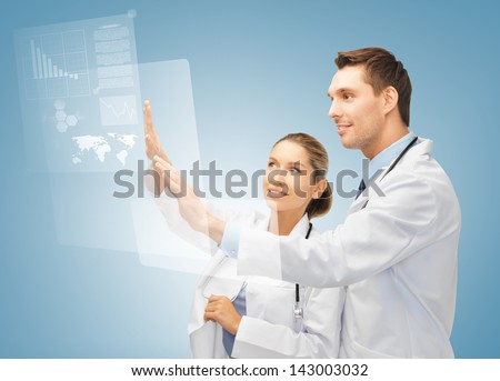 picture of two doctors working with virtual screen - stock photo