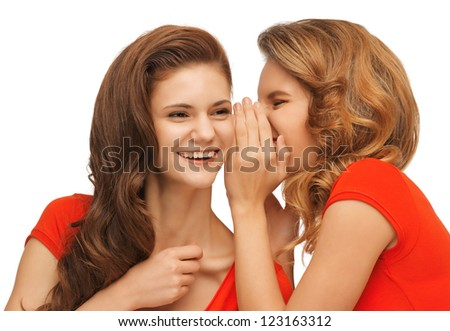 picture of two talking teenage girls in red t-shirts