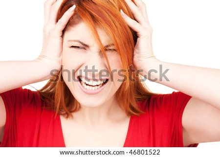picture of unhappy redhead woman with hands on ears - stock photo