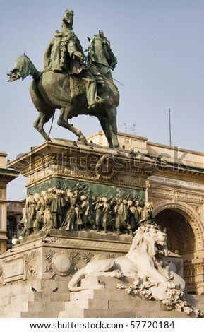 Picture of Vittorio Emanuele II Statue (Ercole Rosa, 1896) in Piazza del Duomo, Milan, Italy; shopping center Galleria Vittorio Emanuele II on the background - stock photo